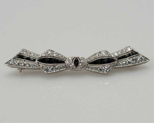 Art Deco onyx and diamond platinum brooch