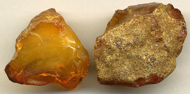 """Amber (resinite) (Baltics),"" left piece is 2.7 cm across, right piece is 3.1 cm across, by James St. John is licensed under CC By 2.0"
