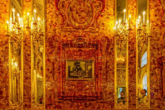 "The celebrated Amber Room was originally constructed in the 18th century in the Catherine Palace near St. Petersburg. The room was decorated with panels made from amber and backed with gold leaf. This ""Eight Wonder of The World"" was looted during WWII and has disappeared. A reconstruction project was begun in 1979 and completed in 2003. This is the reconstructed chamber in the Catherine Palace. ""The Amber Room"" by Dmitry Karyshev is licensed under CC By 2.0"