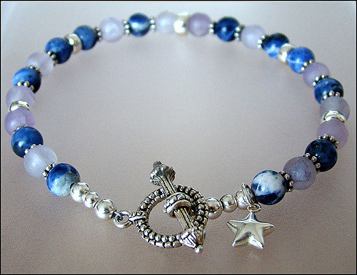 """Denim and Lavender Bracelet,"" featuring blue denim lapis lazuli and lavender fluorite gemstones, by Christine Leiser is licensed under CC By 2.0"