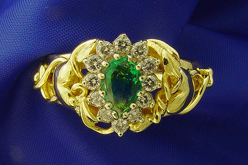 gold, emerald, and diamond ring - gemstone collection