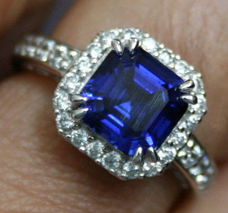 blue sapphire with halo ring setting