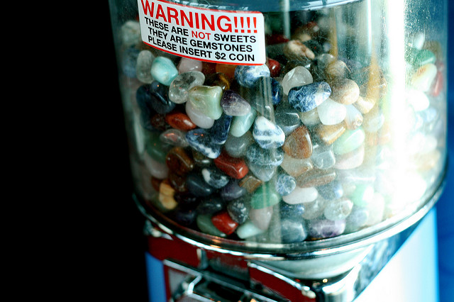 "Bold heading. Borders. Clear content. Not sweets, but your mouth is watering. Call to action. Ask for the sale. Pretty effective advertising for these gemstones. ""Gemstone Dispenser"" by Sarah-Rose is licensed under CC By-ND 2.0"