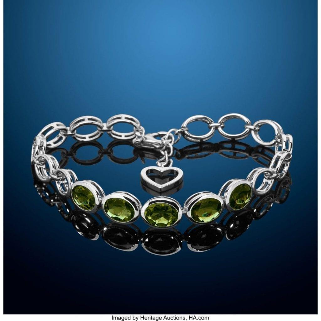 oval-cut moldavites in a bracelet
