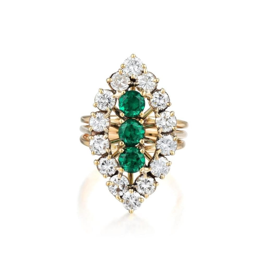 gold ring with diamonds and synthetic emeralds
