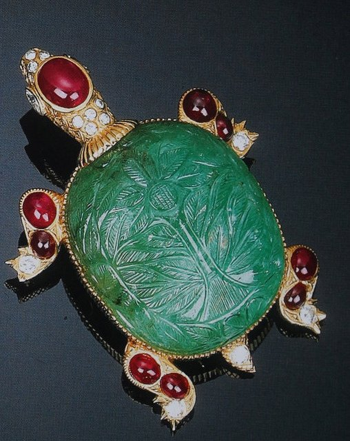 """Cartier Paris Carved Emerald Turtle Pin"" by Clive Kandel is licensed under CC By-ND 2.0"