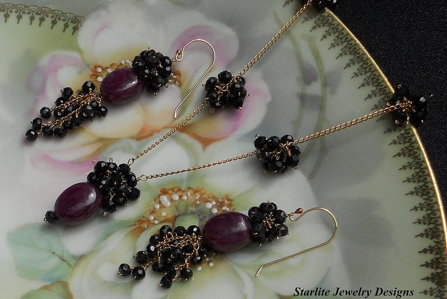 """Ruby Cabochon Necklace and Earrings ~ Accented with Black Spinel ~ Ruby Drop Necklace"" by Naomi King, Starlite Jewelry Designs, is licensed under CC By 2.0"