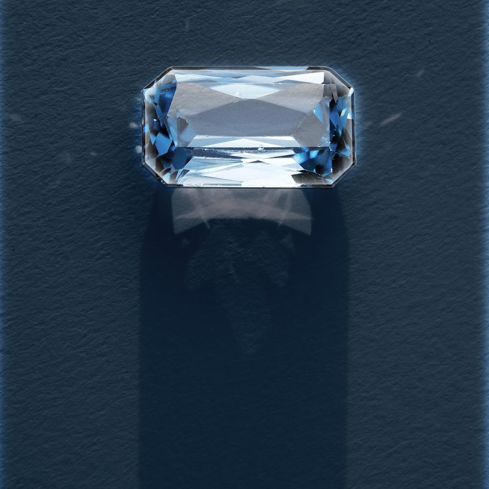 faceted aquamarine on paper