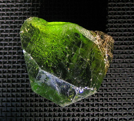 Olivine. Photograph taken at the Natural History Museum, London. By Aram Dulyan (User:Aramgutang) (Own work) [Public domain], via Wikimedia Commons
