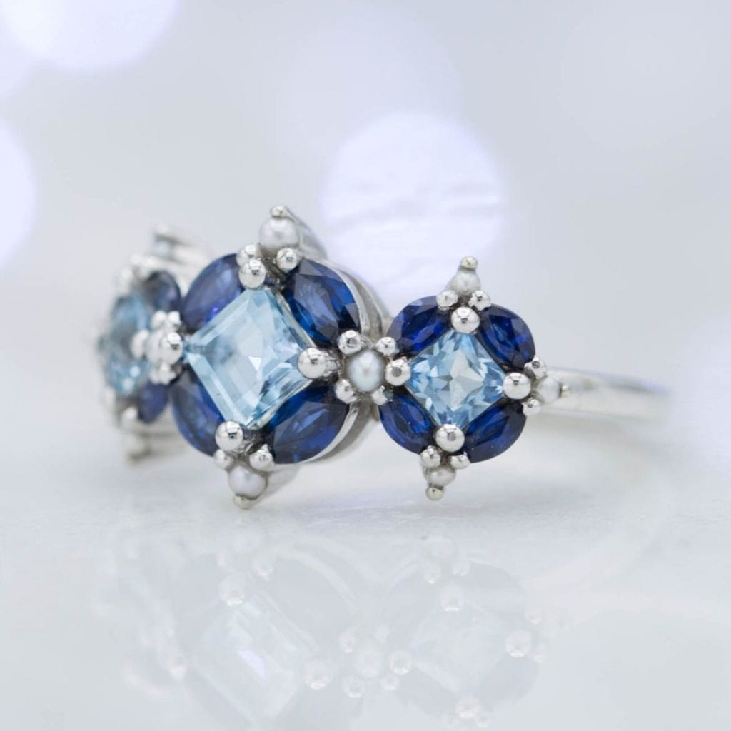 custom aquamarine, sapphire, and pearl ring