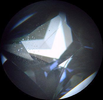 identifying inclusions - blue gemstone