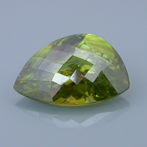 sphene 19 before - repaired and recut gems
