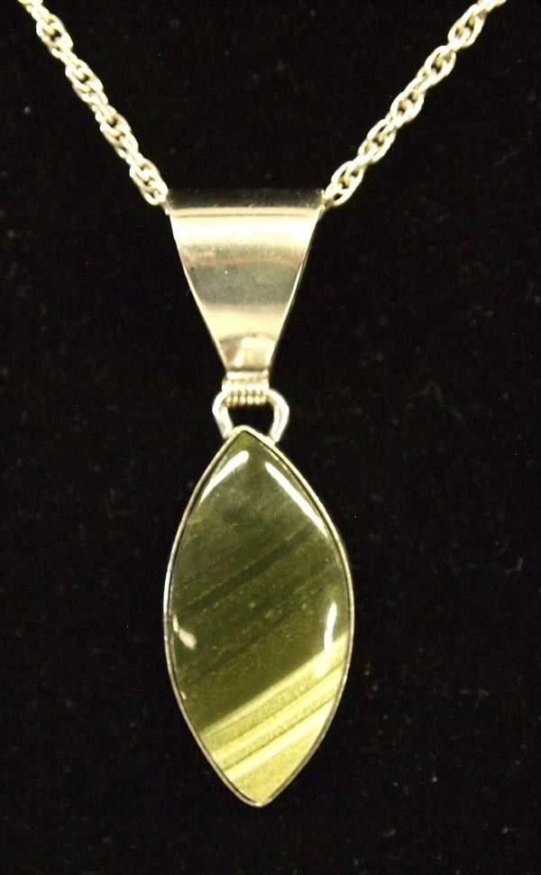 Navajo sterling silver and ricolite pendant