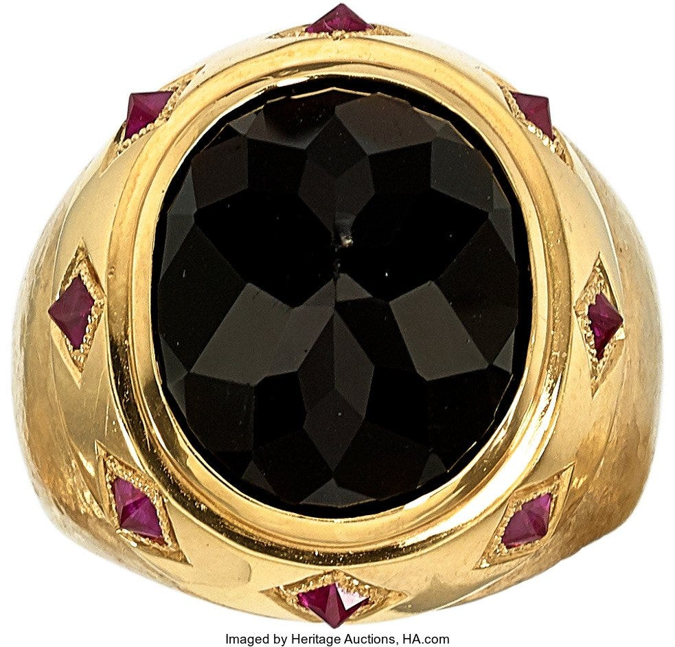 gold ring with tektite and rubies