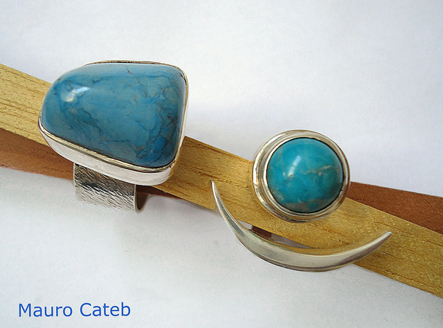 """Silver and turquoise rings"" by Mauro Cateb is licensed under CC By 2.0"