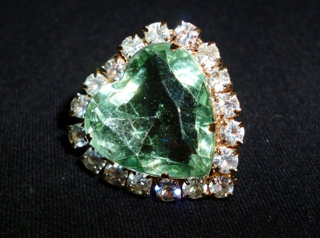 """Heart of Stones,"" heart-shaped emerald and diamonds, by Iqbal Osman is licensed under CC By 2.0"