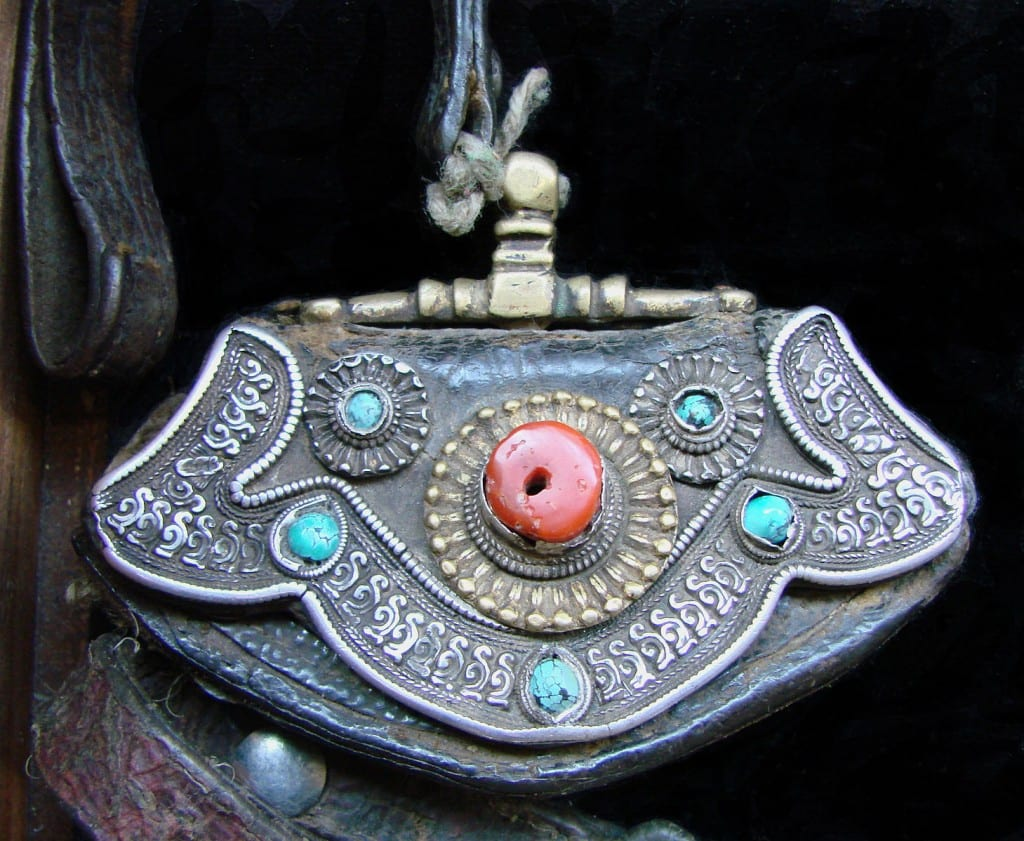 """Object from Tibet 2,"" tobacco pouch made from leather, silver, bronze, coral, and turquoises, by Vassil. Public Domain."