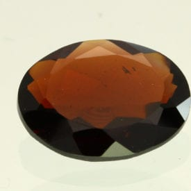 reddish brown staurolite - oval cut, Brazil