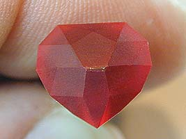 All crown facets are cut in - heart ruby