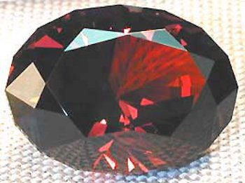 rainbow-cut malaya garnet by Jeff Graham