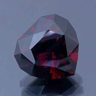 Brilliant Cleftless Heart Cut Malaya Garnet, Nigeria, 4.60 cts