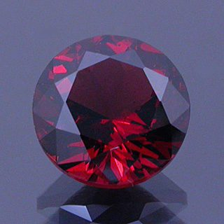 Modified Round Brilliant Cut Malaya Garnet, Likely Tanzania, 1.94 cts