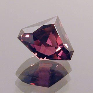 Freeform Cut Fuschia-Red Sapphire