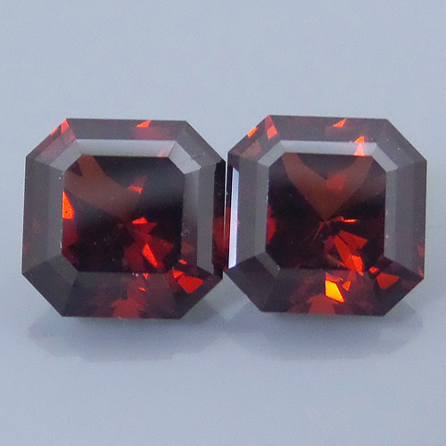 Finished version of Square Barion Cut Malaya Garnet Pair