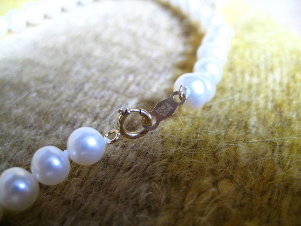 pearl necklace with knots - opal and pearl care guide