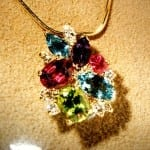 """Birthstones are popular choices for personalizing jewelry.  This pendant features the birthstones of family members.  If you're looking for alternative birthstone choices, read on for systems based on astrology, seasons, and even hours of birth!  """"Mother's pendant..."""" by gemteck1 is licensed under CC By 2.0"""