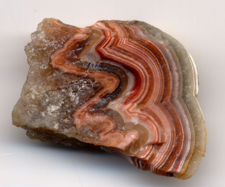 "This banded agate specimen is one inch (2.5 cm) wide. ""Agate Banded 750 pix"" by Adrian Pingstone. Public Domain."