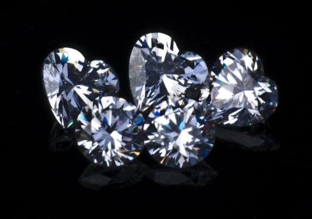 assorted diamonds - diamond overgrading