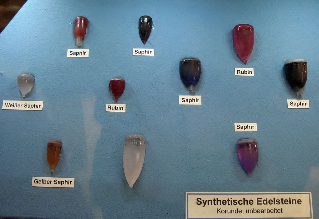 "Rubies and sapphires are varieties of corundum. Our synthetic gemstone guide explains how they are created in laboratories. ""Corundum synthetic, melting bulbs – Exposed in the Mineralogical Museum, Bonn, Germany"" by Ra'ike is licensed under CC By-SA 3.0"