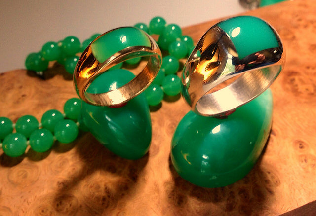 """Chrysoprase inlay rings in sterling and 14k gold. Carved, cast, and inlay all done in-house by Mark Anderson"" by Jessa and Mark Anderson is licensed under CC By 2.0"