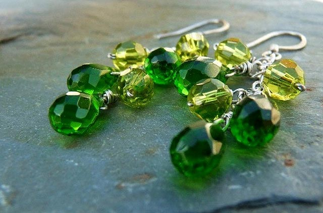 "Emeralds and peridots can coexist, if you carefully compare their colors side by side before purchasing. ""Green Grapes – Emerald and Peridot Briolette Cluster Earrings"" by Natalia Photos is licensed under CC By-SA 2.0"
