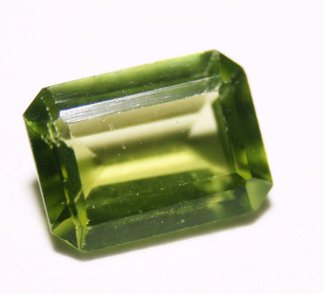 "The healing properties of peridot gems are said to affect areas ranging from emotional to digestive well-being. If you're thinking of wearing gemstones on a ring for health reasons, or any reason, carefully consider the jewelry setting, the durability of the stones, and your comfort. ""Emerald Cut Peridot Ready To Set in Jewellery"" by Michelle Jo. Public domain."