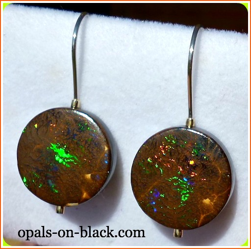"Opal doublets and triplets make use of opal too thin to use as a solid gemstone. A thin layer of precious opal is glued to a black base, usually common opal. ""EB217-G Enchanting Jundah Boulder Opal Doublet Silver & Gold Earrings"" by Opals-On-Black.com is licensed under CC By 2.0"