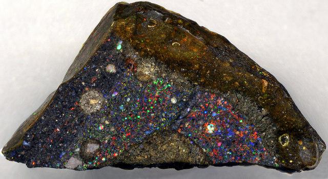 """Precious Opal (Tablon Mine, near Erandique, southeastern Lempira Department, western Honduras) 1"" by James St. John is licensed under CC By 2.0"