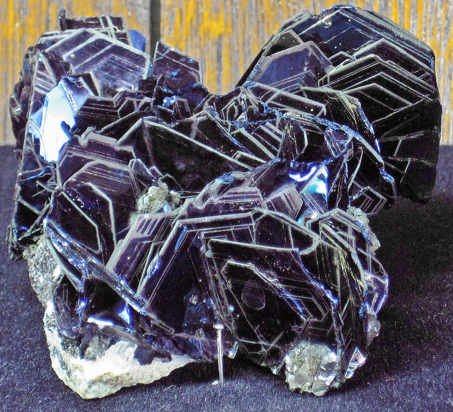 "Covellite is a very attractive crystal, but it's too soft to facet. ""Covellite (latest Cretaceous to earliest Tertiary, 62-66 Ma; Leonard Mine, Butte, Montana, USA) 5"" by James St. John is licensed under CC By 2.0"