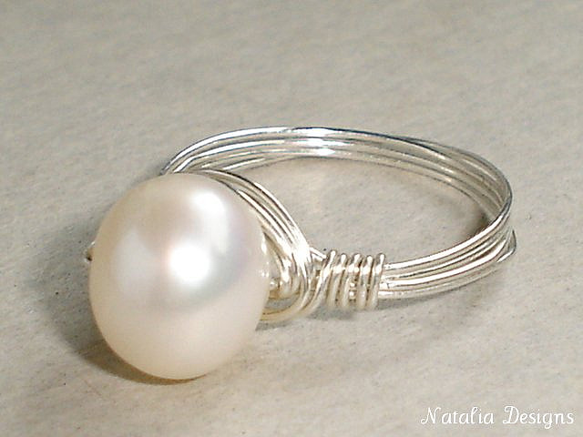 """Snow White Culture Pearl Sterling Silver Wire-wrapped ring"" by Natalia Photos is licensed under CC By-SA 2.0"