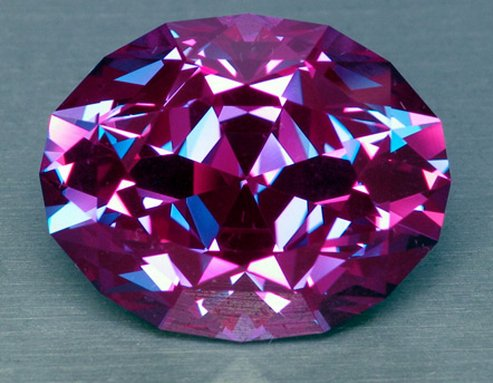 "Natural alexandrite is very rare and quite stunning. These factors help create a market for synthetic alexandrite as an option for jewelry. Synthetic alexandrite is real alexandrite created in a lab. ""55.88 ct Synthetic Alexandrite."" © All That Glitters. Used with permission."