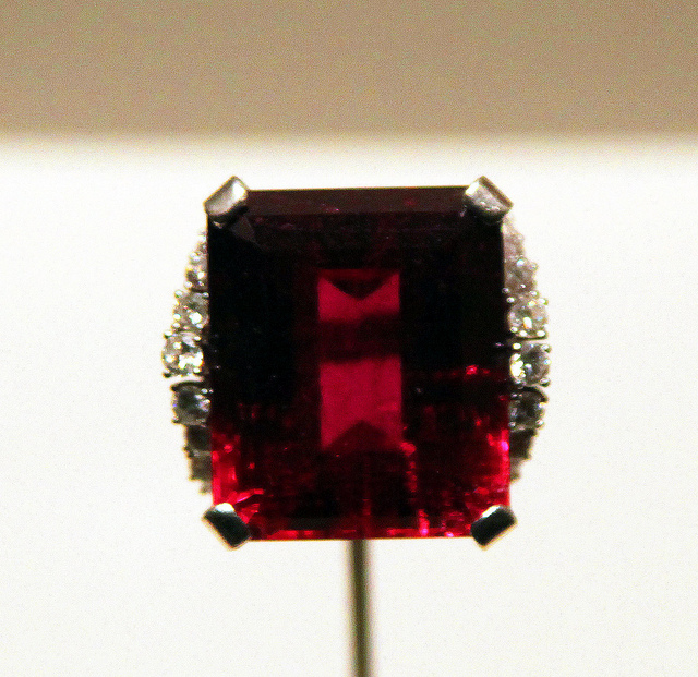 "Rubellite is a variety of dark pink to red tourmaline. Stones with ruby red color are highly valued. ""Elbaite with Rubellite 01"" by Tim Evanson is licensed under CC By-SA 2.0"