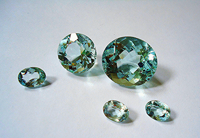 "Can aquamarines be as bright as cubic zirconia? Gemstone brightness is determined by many factors, including the gem's refractive index. ""Aquamarines"" by Mauro Cateb is licensed under CC By 2.0"