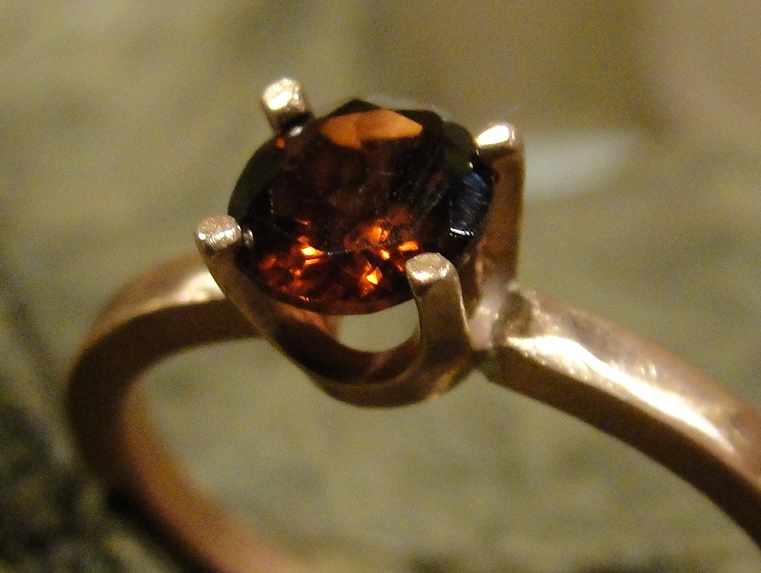 """Garnet Ring"" by Paul the Jewelry Artist is licensed under CC By-ND 2.0. (Cropped to show detail)."