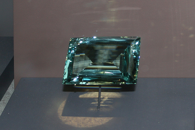 "Natural aquamarine is pleochroic. It shows two different colors when viewed from different angles. Aquamarine can show blue from one angle and green or colorless from another. This phenomena doesn't mean that aquamarines which are colorless from one angle can be called white aquamarines. ""Beryl (Aquamarine) ""Most Precious"" by Cliff is licensed under CC By 2.0"