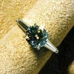 """Custom-cut gemstones don't fit into the mass production process.  However, they can fit into unique jewelry designs.  This hand-made platinum ring features a 2.56 ct. center diamond and custom-cut, very thin, tapering baguette diamonds only 8mm long on each side.  """"Special diamonds..."""" by gemteck1 is licensed under CC By 2.0"""