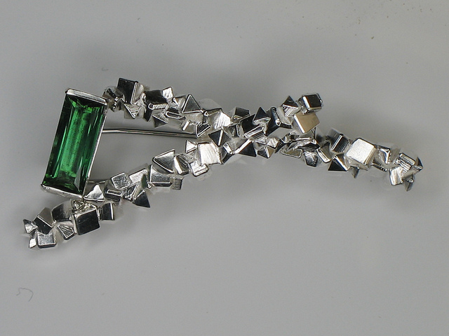 """Chris Boland - Cube Brooch: Cast and soldered silver brooch set with green tourmaline. 70Mm"" by Design Initiative is licensed under CC By-SA 2.0"