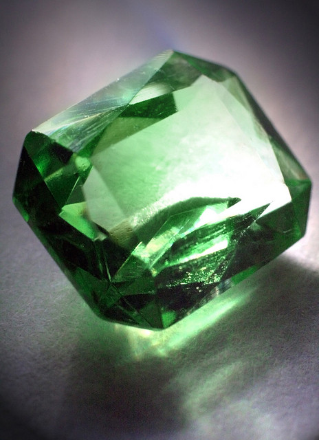 "Sometimes gems like green cubic zirconia or synthetic spinel triplets are used as emerald imitations or simulants. Even glass pieces can be designed to simulate emeralds. However, the chemical and physical properties of these imitations are not those of emeralds. ""Glass Emerald"" by Michelle Tribe is licensed under CC By 2.0"