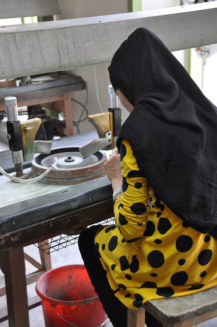 """Untitled,"" an artisan polishes gems during the reopening of the refurbished Turquoise Mountain Foundation in the heart of Kabul's Old City, Afghanistan, on Monday, May 09, 2011(Mireille Zieseniss/Department of State), by US Embassy Kabul Afghanistan is licensed under CC By-ND 2.0"