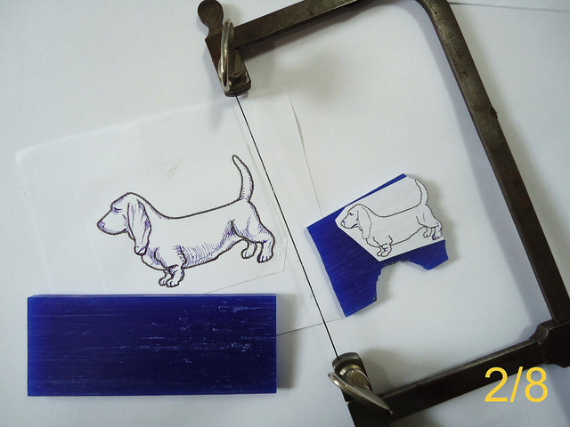 "A drawing is used as a template to cut a design into wax. ""Basset Hound pendant – 2/8"" by Mauro Cateb is licensed under CC By 2.0"
